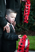 Remembrance Sunday Hackney 13.11.11. Four year old Michael with a wreath in memory of his great grandfather who served in the Second World War and died two years ago.