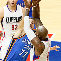 02 November 2016: Los Angeles Clippers center Marreese Speights (5) takes a jump shot over Oklahoma City Thunder center Joffrey Lauvergne (77) during the Oklahoma City Thunder 85-83 victory over the Los Angeles Clippers, at the Staples Center, Los Angeles, California, USA.