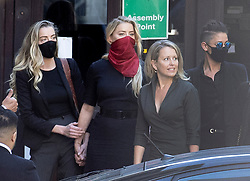 © Licensed to London News Pictures. 07/07/2020. London, UK. US actor Amber Heard (red facemask) arrives with supporters at The High Court in Central London with Australian lawyer Jennifer Robinson (2R) and Amber Heard (L). Johnny Depp's libel trial against The Sun newspaper is due to take place over the next three weeks over allegations he was violent and abusive towards his ex-wife Amber Heard. Photo credit: Peter Macdiarmid/LNP