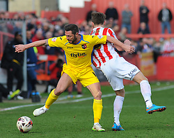 Cheltenham Town's Wes Burns loses the ball to Exeter City's Jamie McAllister. Photo mandatory by-line: Nizaam Jones - Mobile: 07966 386802 - 21/03/2015 - SPORT - Football - Cheltenham - Whaddon Road - Cheltenham Town v Exeter City - Sky Bet League Two
