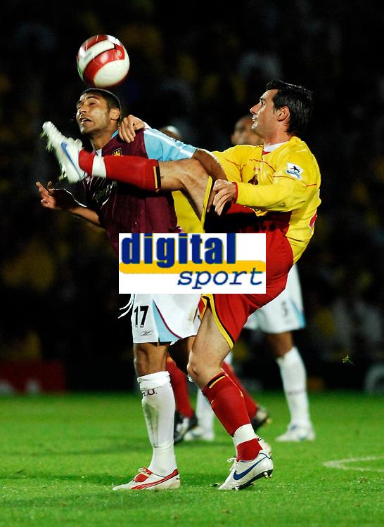 Photo: Richard Lane.<br />Watford v West Ham United. The Barclays Premiership. 22/08/2006. Watford's Matthew Spring kicks clear as West Ham's Hayden Mullins challenges.