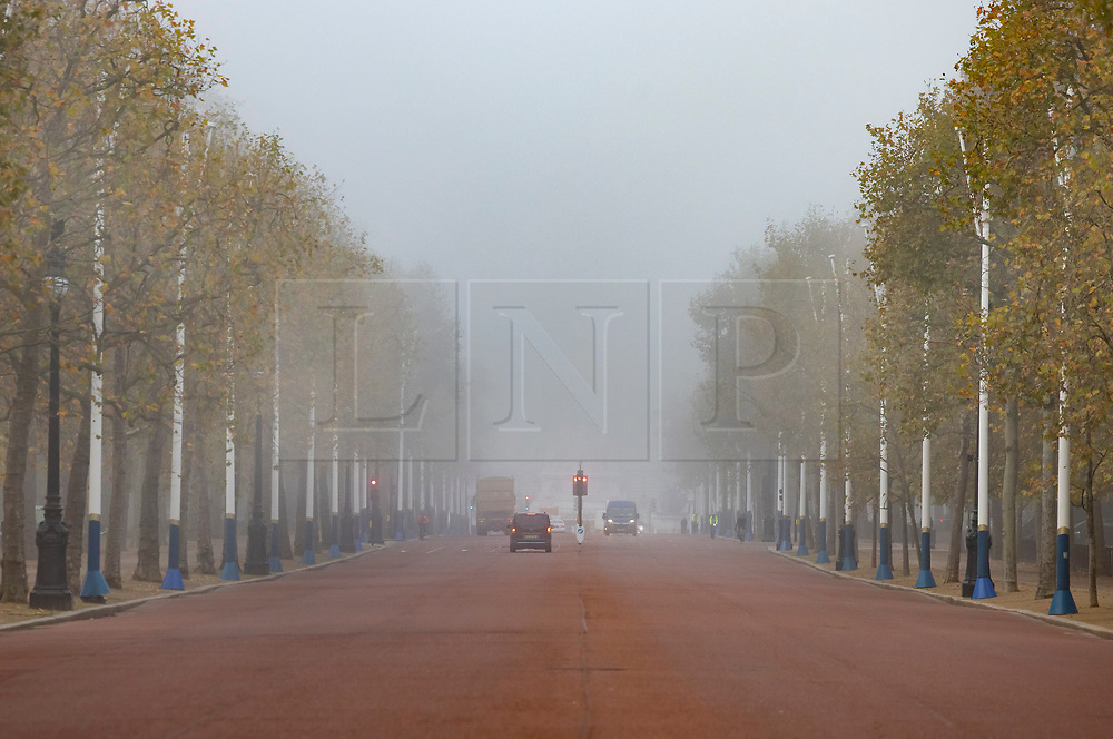 © Licensed to London News Pictures. 05/11/2020. London, UK. Buckingham Palace and The Mall in central London are shrouded in fog on the first day of England's national lockdown. Photo credit: London News Pictures
