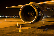 Traffic cones guard against night time accidents under a Boeing engine during an airliner's overnight stop at Heathrow Airport