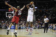 LeBron James of Cleveland shoots over Kasib Powell..The Miami Heat lost to the host Cleveland Cavaliers 84-76 at Quicken Loans Arena, April 13, 2008...