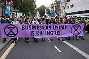Protesters on Whitehall at Extinction Rebellion demonstration on 3rd September 2020 in London, United Kingdom. With government resitting after summer recess, the climate action group has organised two weeks of events, protest and disruption across the capital. Extinction Rebellion is a climate change group started in 2018 and has gained a huge following of people committed to peaceful protests. These protests are highlighting that the government is not doing enough to avoid catastrophic climate change and to demand the government take radical action to save the planet.