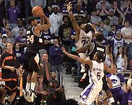 Oklahoma State guard Jameson Curry (24) fires a three pointer over Kansas State's Cartier Martin (20) and Clent Stewart (5) at Bramlage Coliseum in Manhattan, Kansas, February 4, 2006.  The Cowboys  defeated K-State 63-61.