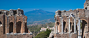 View of Mount Etna volcano from ruins of the ancient Greek Theatre amphitheatre - Teatro Greco - of Taormina, East Sicily, Italy