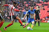 Shaun Whalley of Shrewsbury Town (7) takes a shot at goal during the EFL Trophy Final match between Lincoln City and Shrewsbury Town at Wembley Stadium, London, England on 8 April 2018. Picture by Stephen Wright.