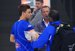 © Licensed to London News Pictures. London, UK. 27/04/2014. London, UK.  Britain's Tom Daley is attended by medical staff after finishing fifth at the FINA Diving World Series final at the Aquatics Centre, Queen Elizabeth Olympic Park. Photo credit: LNP