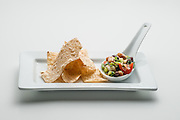 Tray with texas caviar salsa and corn tortilla chips.