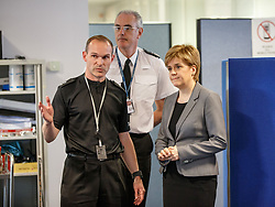 First Minister Nicola Sturgeon meets Chief Constable of Police Scotland Phil Gormley (centre) and emergency services at the Multi Agency Coordinator Centre in Govan, Glasgow.