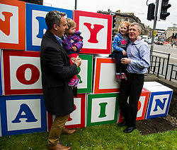 """Pictured: Alex Col-Hamilton and his daughter  Darcy along with Alexa Lang helped Willie Rennie build his pledge<br /> <br /> Scottish Liberal Democrat leader Willie Rennie made his final pitch for votes today as he unveiled large building blocks that spelt out the party's flagship """"Penny for education"""" policy. Scottish Liberal Democrats HQ, 4, EH12 5DR. Adam Clarke 07450 980 386.the election on Thursday.<br /> <br /> Ger Harley 