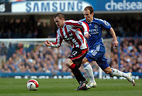 Photo: Tony Oudot.<br />Chelsea v Sheffield United. The Barclays Premiership. 17/03/2007.<br />Alan Quinn of Sheffield United goes past Arjen Robben of Chelsea