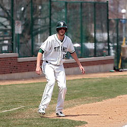 12 April 2014:  Jon Frericks takes a lead at 3rd base during an NCAA division 3 College Conference of Illinois and Wisconsin (CCIW) baseball game between the Augustana Vikings and the Illinois Wesleyan Titans at Jack Horenberger Stadium, Bloomington IL
