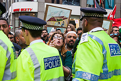 Kesnington, London, July 11th 2014. Police contain crowds as thousands of Palestinians and their supporters demonstrate against the latest wave of Israeli retaliatory attacks on Palestinian targets and homes, where casualties are steadily mounting.