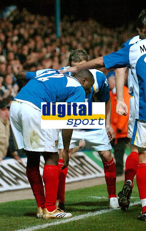 Photo: Ed Godden.<br />Portsmouth v Arsenal. The Barclays Premiership. 12/04/2006. Lomana Lua Lua, injures himself after his goal celebrations.