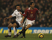 Photo: Javier Garcia/Back Page Images<br />Fulham v Manchester United, FA Barclays Premiership, Craven Cottage 13/12/04<br />Roy Keane is watched by Steed Malbranque