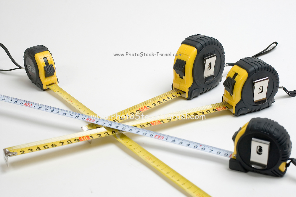 4 yellow and one unique white measuring tape on white background