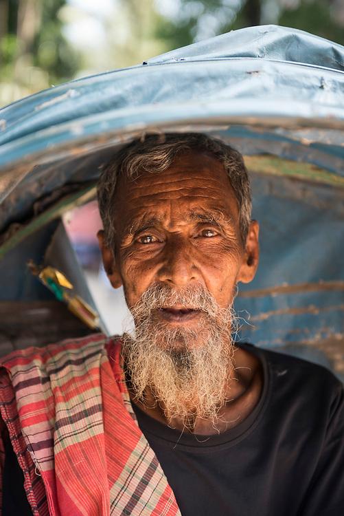 Portrait of an 85-year-old cycle rickshaw driver in Dhaka, Bangladesh