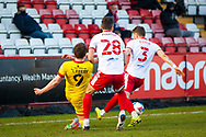 Joe Martin of Stevenage and Ben Coker of Stevenage tackle Caolan Lavery of Walsall together during the EFL Sky Bet League 2 match between Stevenage and Walsall at the Lamex Stadium, Stevenage, England on 20 February 2021.