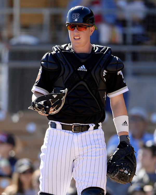 GLENDALE, ARIZONA - MARCH 06:  Zach Collins #86 of the Chicago White Sox catches during a spring training game against the San Diego Padres on March 6, 2017 at Camelback Ranch in Glendale Arizona.  (Photo by Ron Vesely)   Subject:   Zach Collins