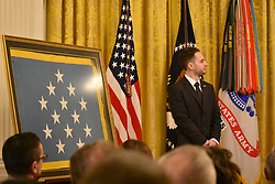 March 27, 2019 - Washington, United States - President Donald J. Trump awarded the Medal of Honor posthumously to Staff Sergeant Travis W. Atkins, United States Army, for conspicuous gallantry. Mr. Trevor Oliver, son of Staff Sergeant Atkins, joined President Trump in the East Room of the White House to accept the award and to commemorate his father's selfless service and sacrifice on March 27, 2019  (Credit Image: © Kyle Mazza/NurPhoto via ZUMA Press)