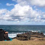 Tourists explore the rocks along the cost at La Roche qui Pleure, a hidden spot along the southern coast of Mauritius.