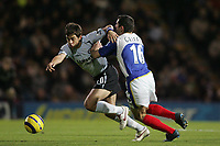 Photo: Lee Earle.<br /> Portsmouth v Chelsea. The Barclays Premiership.<br /> 26/11/2005. Chelsea's Joe Cole (L) battles with Andy Griffin.