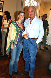Social figure BROOKE DE OCAMPO and MARTIN SUMMERS  at a an exhibition of prints by art dealer Martin Summers held at 73 Glebe Place, London on 29th June 2004.