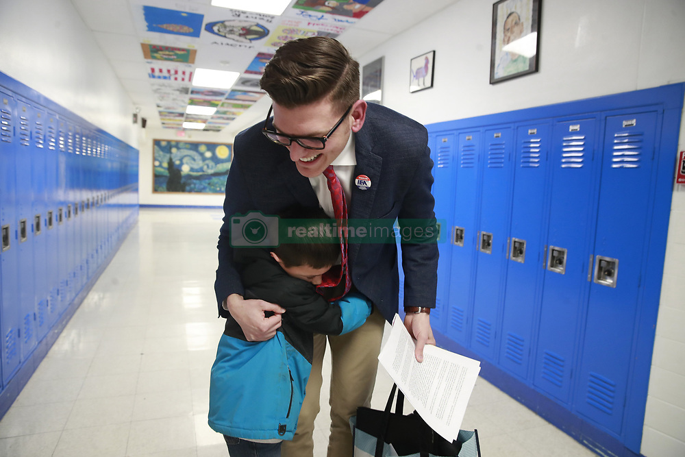 April 16, 2018 - Burlington, IL, USA - Prairie View Elementary School music teacher Nathan Etter gets a hug from Tristan Schwarz, 6, after he spoke on Monday, April 16, 2018 to members of the School Board at Central Middle School in Burlington, Ill. Etter was looking from an apology after he was reportedly told to ''stick to the curriculum'' after he talked to students about being in a same-sex marriage. (Credit Image: © Nuccio Dinuzzo/TNS via ZUMA Wire)