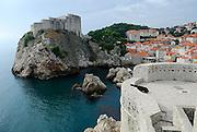 Tower Lovrijenac, with section of Tower Bokar and city walls, overlooking Dubrovnik's oldest harbour, Kalarinja. Dubrovnik old town, Croatia