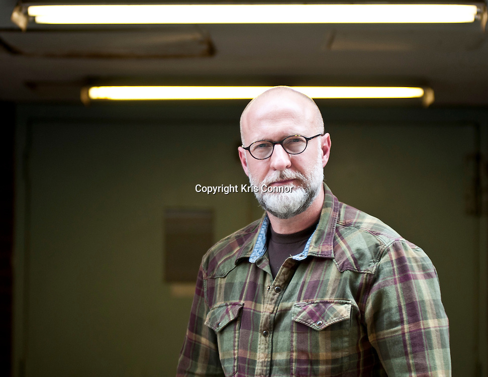 Rock Legion Bob Mould poses for a portrait in the midtown section of Washington DC on June 9, 2011. Photo by Kris Connor