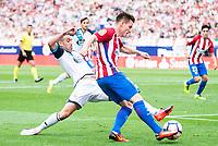 Atletico de Madrid's player Kevin Gameiro and Deportivo de la Coruña's player Fernando Navarro during a match of La Liga Santander at Vicente Calderon Stadium in Madrid. September 25, Spain. 2016. (ALTERPHOTOS/BorjaB.Hojas)