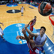 Anadolu Efes's Cedi Osman (R) and Milko Bjelica (2ndL) during their Gloria Cup Basketball Tournament match Anadolu Efes between Olympiacos at Ulker Sports Arena in istanbul Turkey on Tuesday 23 September 2014. Photo by Aykut AKICI/TURKPIX