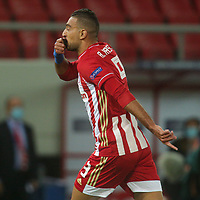 PIRAEUS, GREECE - OCTOBER 21: Ahmed Hassan of Olympiacos FC celebrates his goal during the UEFA Champions League Group C stage match between Olympiacos FC and Olympique de Marseille at Karaiskakis Stadium on October 21, 2020 in Piraeus, Greece. (Photo by MB Media)