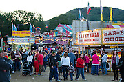 Evening crowds moving between food stalls on the midway, Blue Hill Fair, Maine