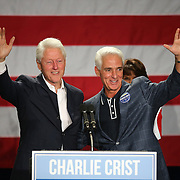 Florida Democratic gubernatorial candidate Charlie Crist (R) waves as he welcomes former president Bill Clinton during a campaign event at the UCF Arena on Monday, Nov. 3, 2014 in Orlando, Florida. (AP Photo/Alex Menendez)