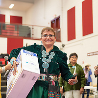 Casamero Lake elder Rose Etcitty, 60, carries her brand new sewing kit after winning first place in the elder fashion show. The event was held in the Wellness Center in Crownpoint on May 07.