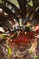 Man from Chimbu Province with Stephanie's Astrapia Bird of Paradise plumes and other feathers in his headdress.  Papua New Guinea..