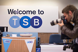 © licensed to London News Pictures. London, UK 09/09/2013. A photographer photographing a new TSB branch in London on the bank's first day of trading as more than 600 branches and eight million accounts have been split from Lloyds in order to meet European competition rules. Photo credit: Tolga Akmen/LNP