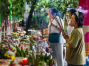 30 AUGUST 2016 - BANGKOK, THAILAND: A woman prays at Wat Mangkon Kamalawat on the last day of Hungry Ghost Month in Bangkok. Chinese temples and shrines in the Thai capital host food distribution events during Hungry Ghost Month, during the 7th lunar month, which is usually August in the Gregorian calendar.         PHOTO BY JACK KURTZ