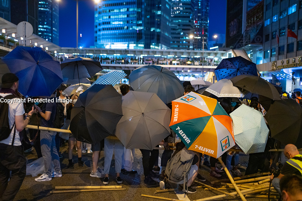 Hong Kong. 4th October 2019. Pro-democracy demonstrations and march in Central district of Hong Kong. Barricade being built on street.