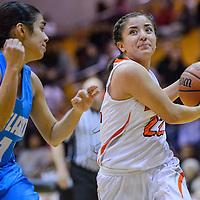 Gallup Bengal Shenoah Begay (22) breaks around Cleveland Storm Alyssa Lucero (21)  Saturday at Gallup High School.