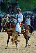 Man riding a decorated horse during a Durbar in Maiduguri, Nigeria