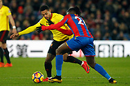 Andre Gray of Watford (L) battles with Bakary Sako of Crystal Palace (R). Premier League match, Crystal Palace v Watford at Selhurst Park in London on Tuesday 12th December 2017. pic by Steffan Bowen, Andrew Orchard sports photography.