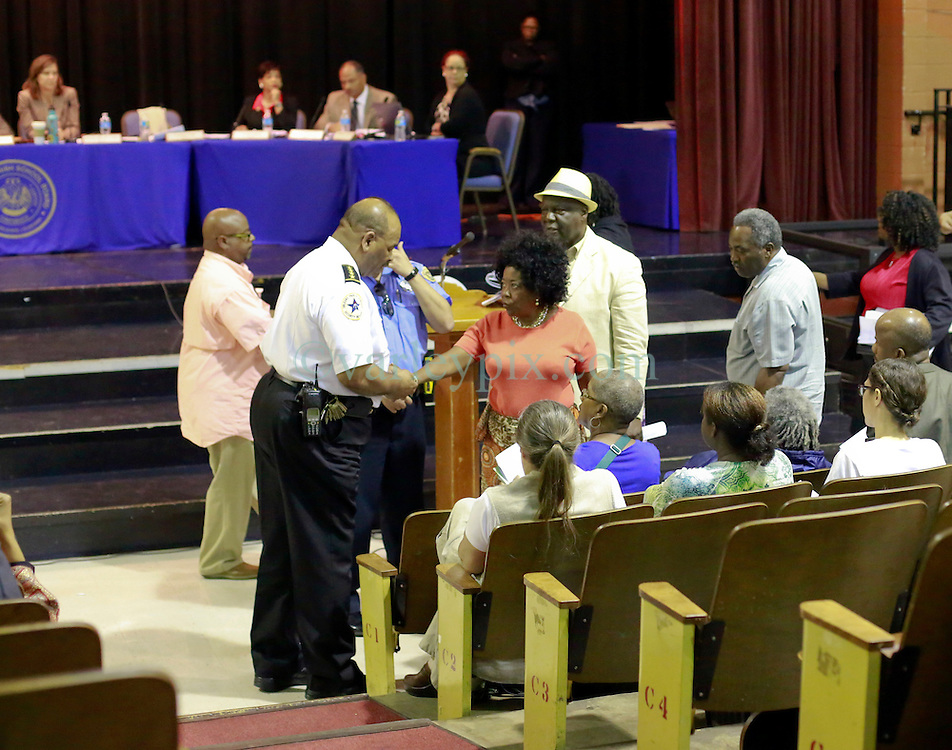 16 September 2014. New Orleans, Louisiana.<br /> Orleans Parish School Board meeting. Celebrations as Lycee Francais is approved to purchase the old blighted Priestley School to redevelop the building into a state of the art school. <br /> Photo Credit; Charlie Varley/varleypix.com