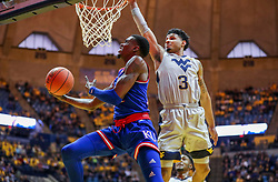Jan 19, 2019; Morgantown, WV, USA; Kansas Jayhawks guard Lagerald Vick (24) makes a move while shooting under the basket during the first half against the West Virginia Mountaineers at WVU Coliseum. Mandatory Credit: Ben Queen-USA TODAY Sports