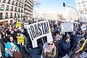 Protestors shout slogans during a demonstration against corruption in Madrid