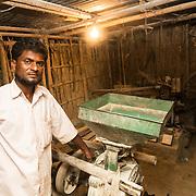 CAPTION: Mohammad Irshad at his wheat mill. LOCATION: Bara, Araria District, Bihar, India. INDIVIDUAL(S) PHOTOGRAPHED: Mohammad Irshad.