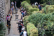 Beneath the remains of Londons Roman wall perimeter, models parade clothing styles during London fashio Week, on 21st September 2021, in the City of  London, England.